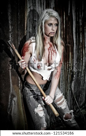 Bloody Horror Scene of a Sexy Woman holding an Axe - stock photo