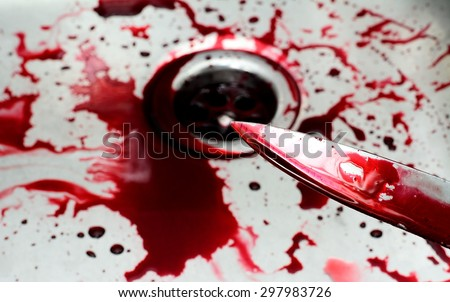 Bloody knife in sink with flowing red blood. Murder concept background
