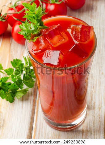 Bloody Mary Alcoholic Drink with fresh  tomatoes. Selective focus - stock photo