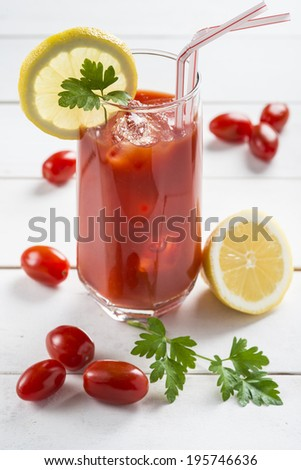 Bloody Mary cocktail garnished with a lemon slice and parsley leaves - stock photo