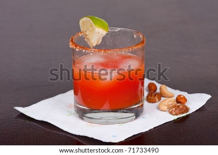 Bloody Mary Cocktail with salt  lime and nuts - stock photo