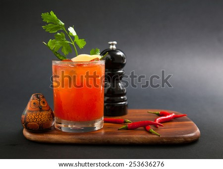bloody mary fresh Cocktail  decorate on wooden cutting board isolated on black, studio - stock photo