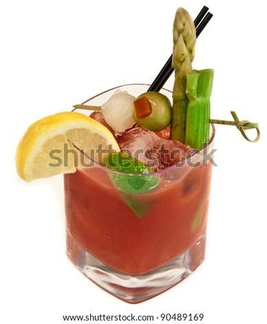 Bloody mary, traditional cocktail isolated on a white background loaded with garnishes - stock photo