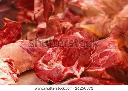bloody meat chunks on market show window - stock photo