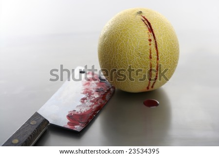 Bloody yellow melon killed by knife. Wound with blood metaphor - stock photo