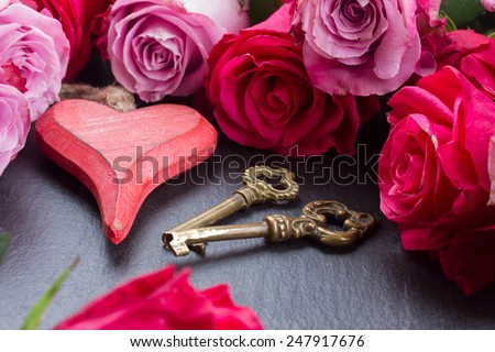 blooming  pink roses   with red heart and pair of vintage keys - stock photo