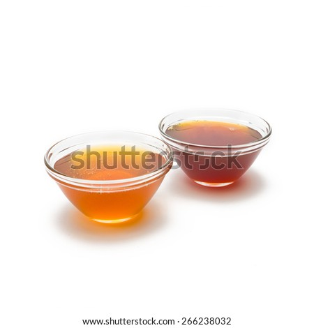 blossom honey and forest honey in shells on white background - stock photo
