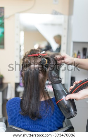 blow-drying in a beauty salon