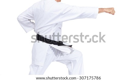 Blow gyaku-Tsuki is beating a man with a black belt