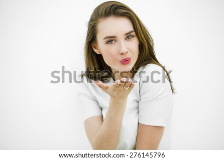 Blow kiss, young caucasian female model isolated on white background - stock photo