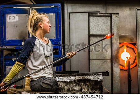Blowing Glass Professional Woman Working on a Vase. - stock photo