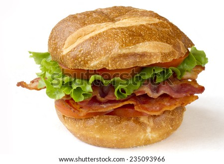 BLT sandwich on pretzel bun. Isolated on white.
