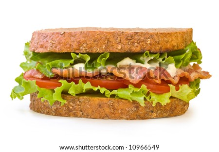 BLT Sandwich. Whole wheat toasted BLT (Bacon, Lettuce, Tomato) sandwich with mayonnaise isolated on white background - stock photo