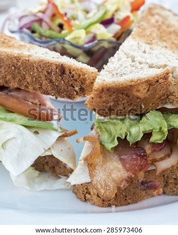 BLT sandwich with whole wheat bread and ready to eat. - stock photo