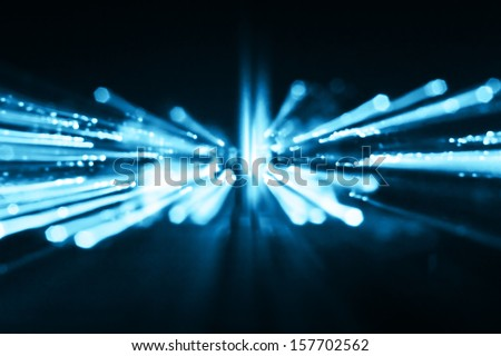 Blue abstract background of out of focus party lights streaks - stock photo
