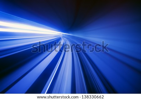 Blue abstract blurred speed motion view in tunnel  of city urban train - stock photo