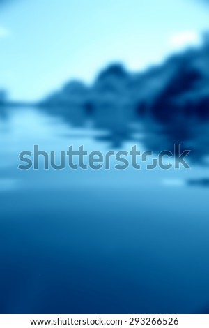 blue abstract defocused background reflected in water