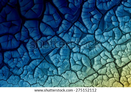 Blue abstract texture of cracked dirt as background - stock photo