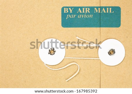 Blue Air Mail print on a brown string envelope.  - stock photo