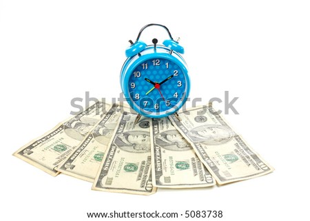 Blue alarm clock with bells over a fan of moneya - stock photo