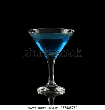 blue alcoholic cocktail in a glass on black - stock photo