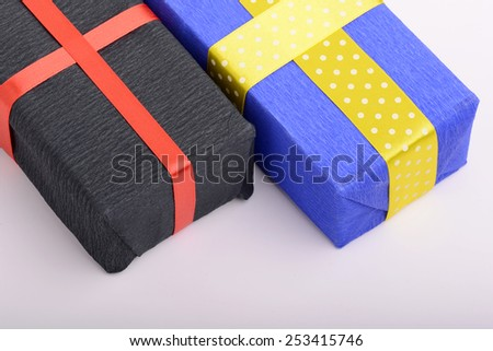 blue and black gift box on white material - stock photo