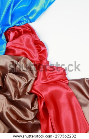 Blue and brown and red silk texture satin velvet material or elegant wallpaper design curve folds wavy background isolated on white background