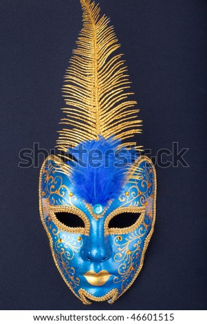 blue and gold mask on a black background