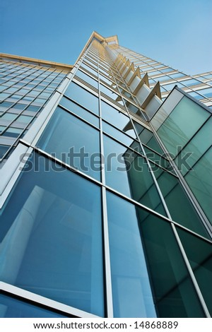 Blue and Green Glass Tower - stock photo