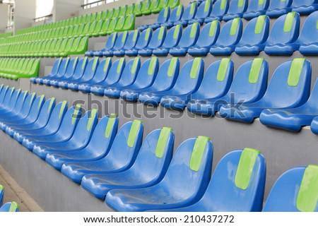 Blue and green stadium seats - stock photo
