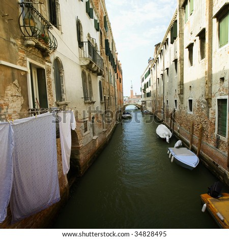 blue and green water of a venetian canal