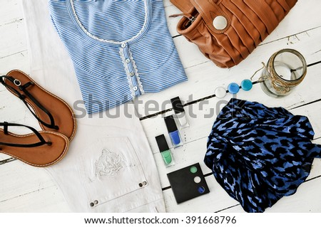 Blue and khaki clothes combinations - stock photo