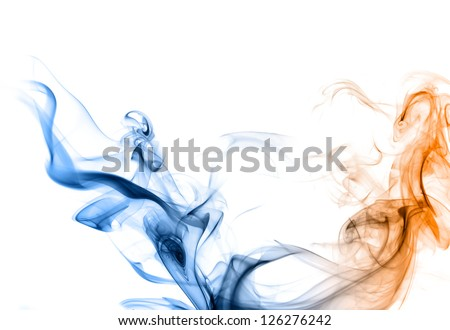 Blue and orange smoke on a white background like a two dragons or snakes. - stock photo