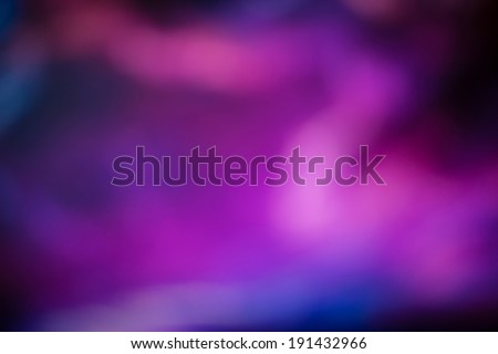 Blue and purple bokeh background - stock photo