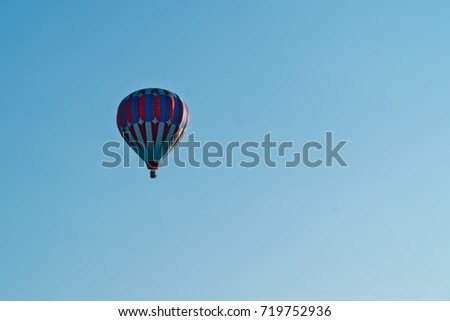 Blue and red hot air balloon on blue sky background on sunny day