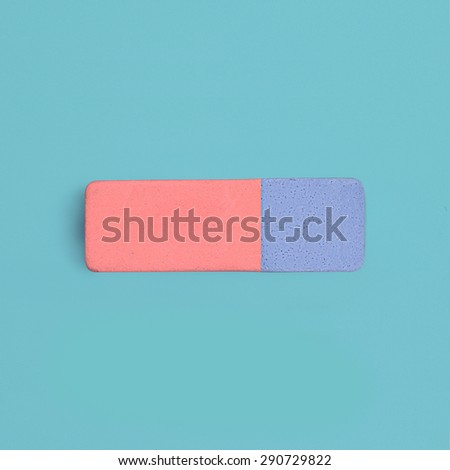 Blue and red rubber pencil eraser view from above on colored background - stock photo