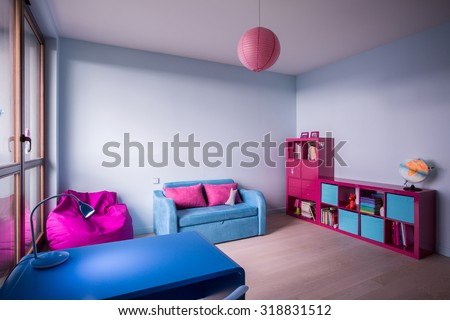 Blue and rose furniture in bedroom for little girl - stock photo