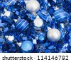 Blue and silver christmas balls on a ribbon background - stock photo