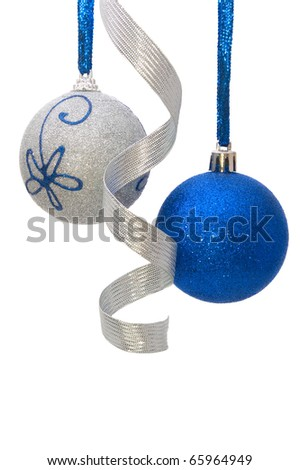 blue and silver christmas balls with curly silver ribbon hanging on white background - stock photo