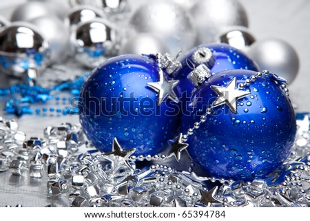 Blue and silver Christmas balls with silver decoration - stock photo