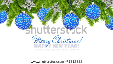 Blue and silver christmas decoration baubles and pine on white background with space for text - stock photo