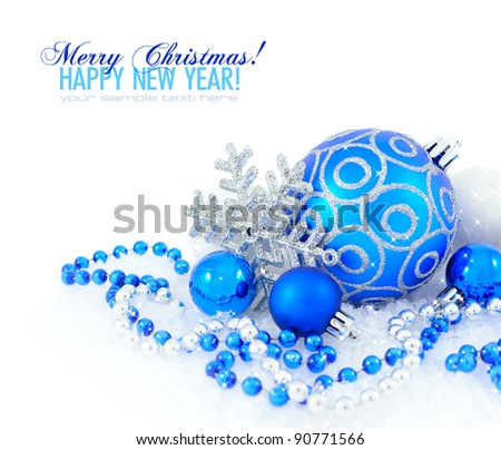 Blue and silver christmas decoration baubles on white with space for text - stock photo