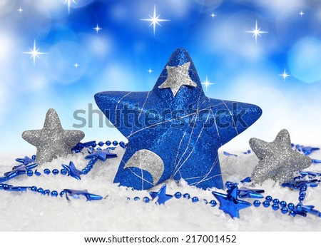 Blue and silver christmas decorations in the shape star - stock photo