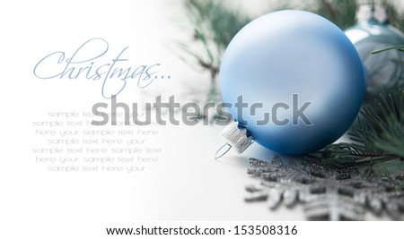 Blue and silver christmas decorations with space for text - stock photo