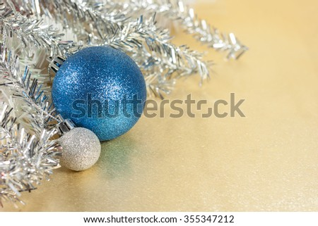 blue and silver xmas ornaments and Tinsel on glitter holiday  background. Merry christmas card. Winter holidays. Xmas theme. Happy New Year.