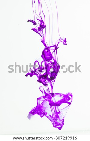 Blue and violet liquid in water making abstract forms  - stock photo