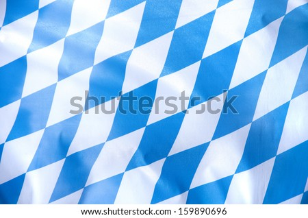 blue and white bavarian flag waving in the wind - stock photo