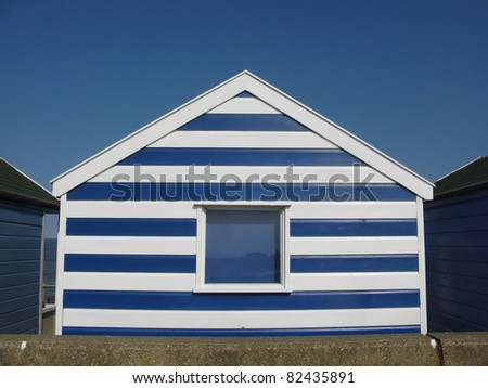 Blue and white beach hut on sunny day in Southwold, Suffolk, England, UK - stock photo