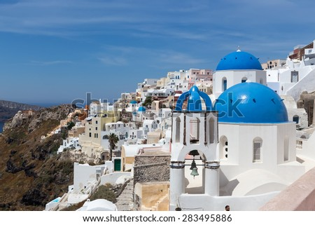 Blue and white church of Oia village on Santorini island. Greece