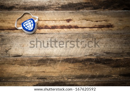 Blue and white dust mask WITH COPY SPACE - stock photo